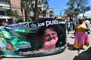 People demonstrate for the liberation of 13 convicted environmentalists with a banner depicting Honduran murdered environmental leader Berta Caceres as they arrive for a hearing in Tegucigalpa.