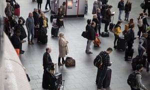 Passengers at King's Cross train station.