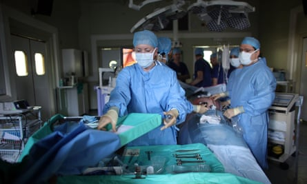 Surgeons operate on a patient