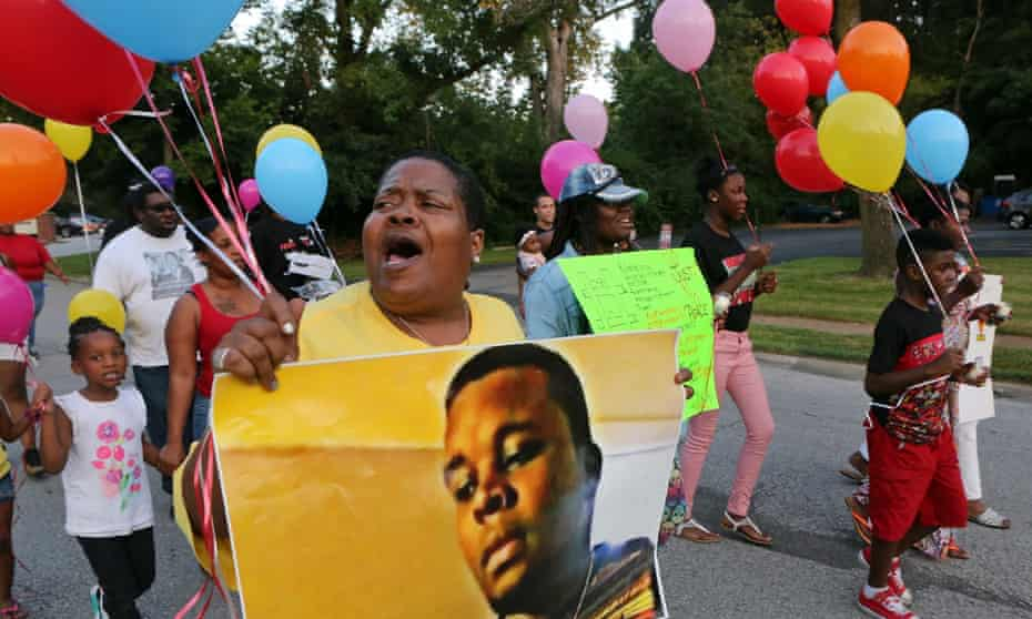 Protesters in Ferguson, Missouri, mark the second anniversary of the shooting of Mike Brown