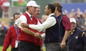 Bjørn shakes hands with Tiger Woods after Europe won the Ryder Cup at the Belfry in 2002.