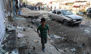 A boy at the site of a suicide bomb attack near a Shia mosque in Kabul in September.