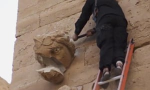 A still from the Isis video posted on YouTube shows a militant attacking an artefact with a sledgehammers
