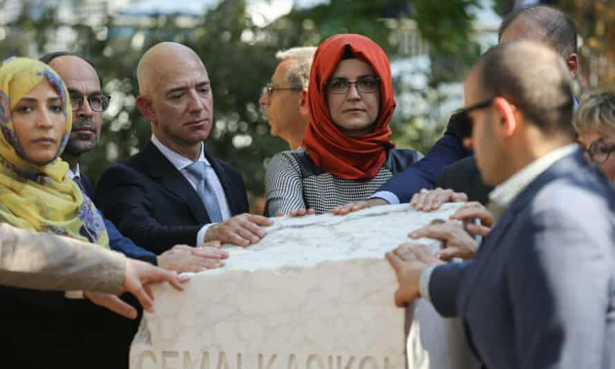 Bezos (third left) and Cengiz (middle) at the unveiling of Khashoggi's monument on 2 October last year, the first anniversary of the journalist's murder.