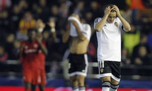 Valencia's Pablo Piatti gestures after a goal by Lyon.