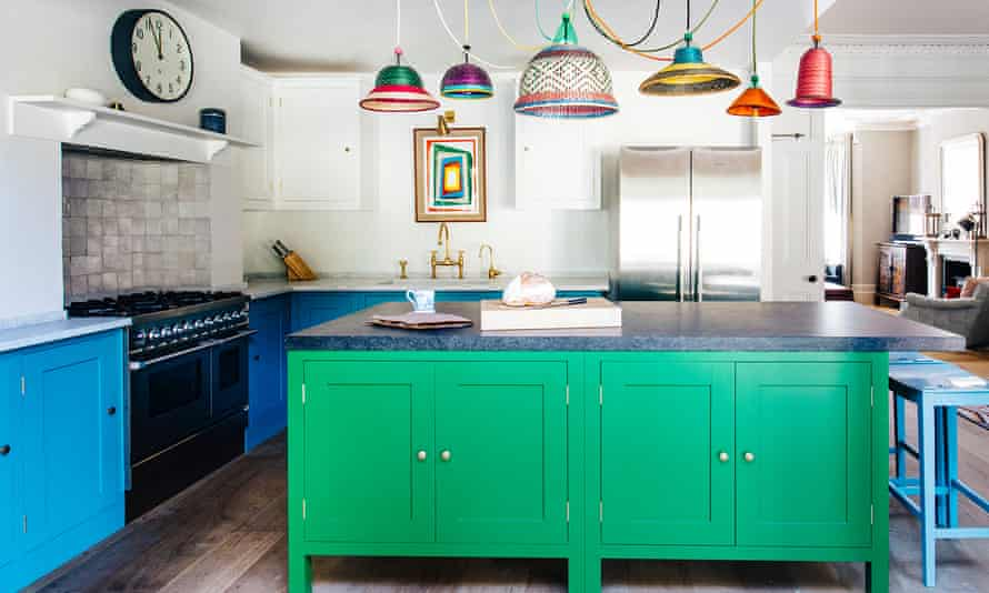 Cabinet shuffle: Harding & Read used bold colours below the eyeline for this striking Plain English kitchen.