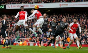 Danny Welbeck heads the winning goal for Arsenal.