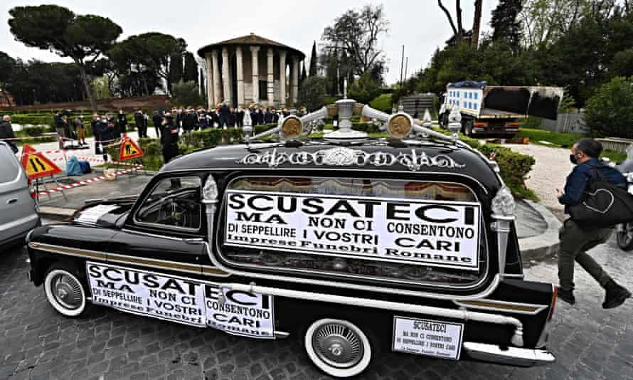 Hearse covered in posters