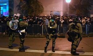 Riot police near a vigil