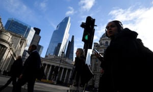 Workers in the City of London financial district as investors fear that the coronavirus outbreak could stall the global economy.