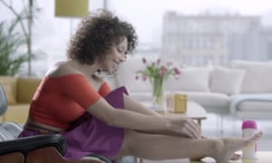 An advert showing a woman just hanging out, shaving her legs on her coffee table.