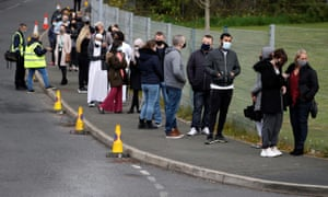 People line up outside a mobile vaccination centre yesterday in Bolton.