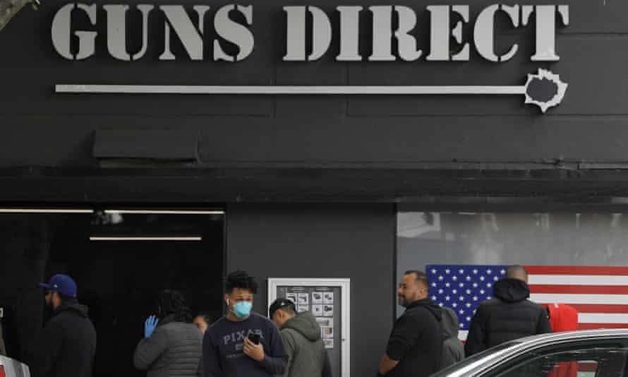 People wait in line outside a gun store in Burbank, California.