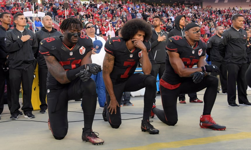 NFL players on knees during national anthem before match