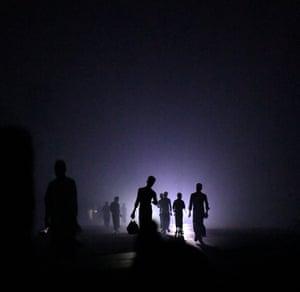 Rohingya refugees leave Shamlapur beach with fish at night to return to Shamlapur camp