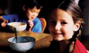 Children eating breakfast.