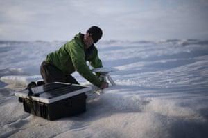 Rougeux installs a GPS antenna at the Helheim glacier.