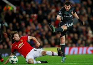 Daley Blind slides in to try and block the shot from Alan Dzagoev.
