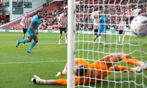 Shaquile Coulthirst scores from the penalty spot to give Barnet a 1-0 lead at Bramall Lane