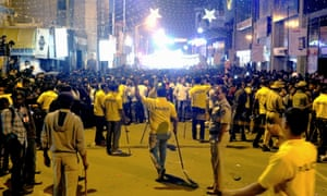 Indian police attempt to manage crowds during New Year's Eve celebrations in Bangalore