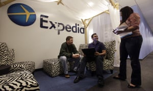 Expedia analytics team workers Mike Brown, left, Saurin Pandya and Prashanti Tata chat in an alcove set up for employees, in Bellevue, Wash.