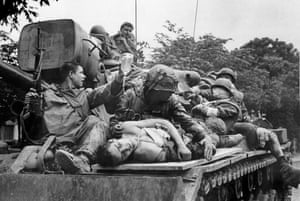 Marines transport their seriously wounded atop a US Army tank through the streets of Hue toward a helicopter evacuation point, February 17, 1968