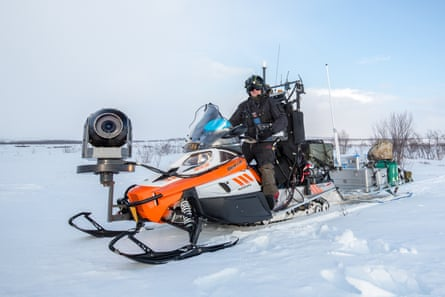 A snowmobile kitted out for filming the migrating reindeer.