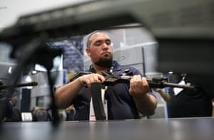 David Monteiro weighs a gun in his hands