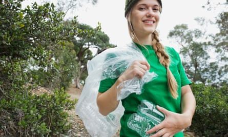 Ploggers go running with a rubbish sack to collect litter.