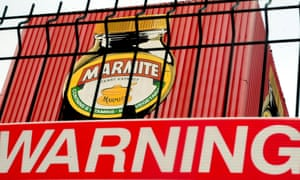 A warning sign below a Marmite logo at Unilever's factory in Burton-on-Trent