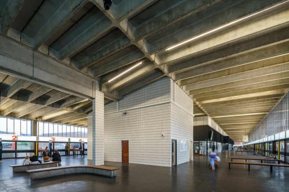 The station's minimalist interior, with iroko benches and black rubber Pirelli floor.