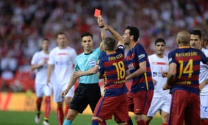 Javier Mascherano is shown the red card despite the protestations of his Barcelona team-mates.