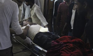 An injured man is brought into hospital in Bara Nepal