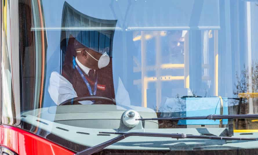 A London bus driver in a mask and gloves, 7 April 2020