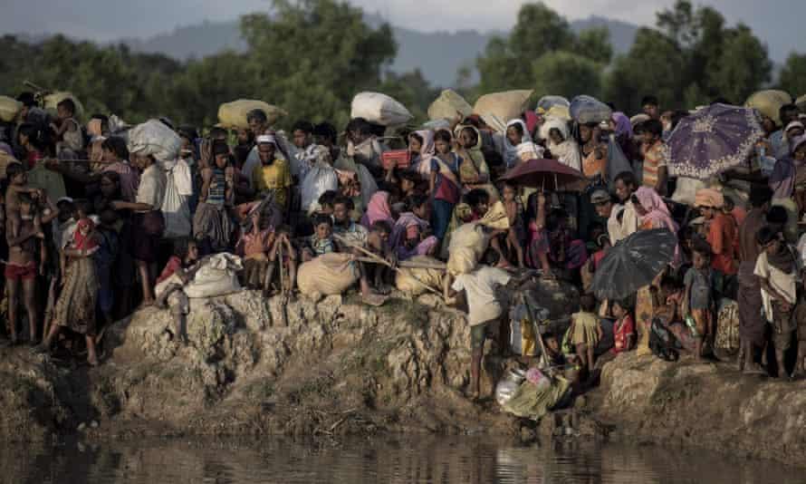 Rohingya refugees flee Myanmar into Bangladesh in 2017.
