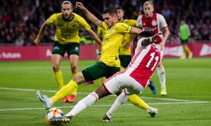 George Cox, on loan at Fortuna Sittard from Brighton, attempts to block a cross by Quincy Promes of Ajax in September.