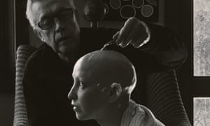 Rebecca Leaver has her head shaved by her father after undergoing chemotherapy.