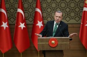 President Recep Tayyip Erdoğan speaks at the presidential palace in Ankara.