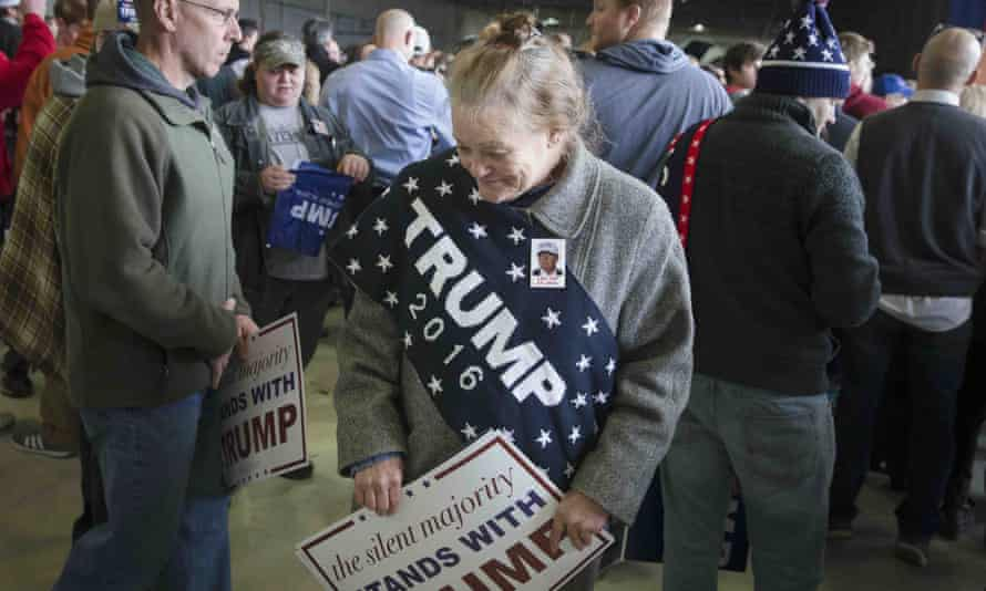 Linda Gore stands in the crowd as she waits for the arrival of Republican presidential candidate Donald Trump speaks ahead of a campaign stop at the Signature Flight Hangar at Port-Columbus International Airport, Tuesday, March 1, 2016, in Columbus, Ohio. (AP Photo/John Minchillo)