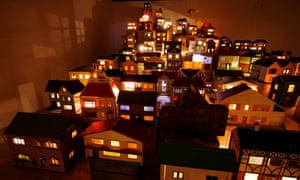 Lighting up time: Place (Village) 2006-08 (mixed media: doll's houses, crates, boxes, wood, electrical fittings and fixtures, electricity).