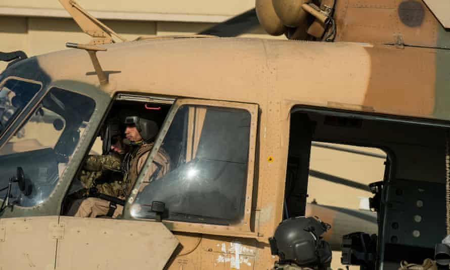 An Afghan air force Mi-17 helicopter pilot prepares to depart Kabul International airport in November 2014