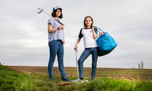 Young climate activists Amy (on left) and Ella Meek, litter-picking in fields in Nottinghamshire