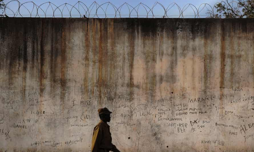A prison guard walks along a perimeter wall at the central prison in Rumbek, in South Sudan's Lakes state