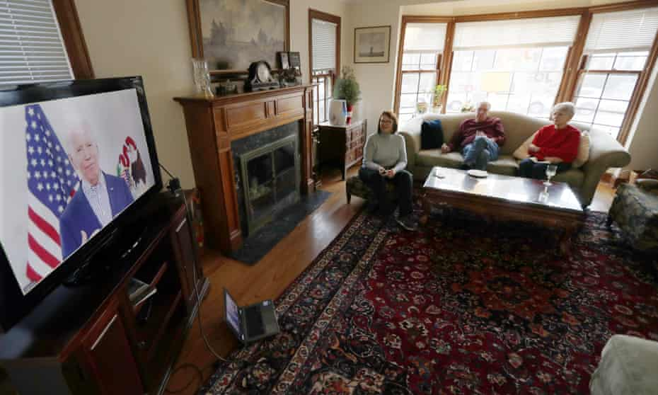 Chicago residents watch Joe Biden during his Illinois virtual town hall on 13 March.