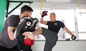 men practicing MMA
