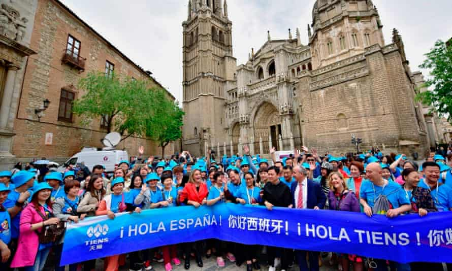 Some of the 2,500 workers of the Chinese firm Tiens Group at Toledo's city hall in Spain.