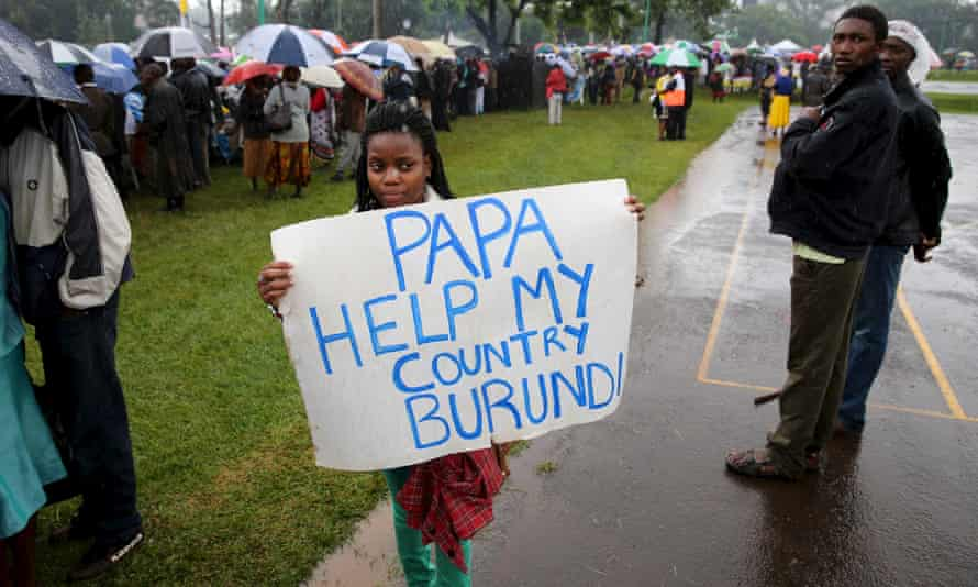 A woman holds a banner before a mass by Pope Francis in Nairobi, November 2015.