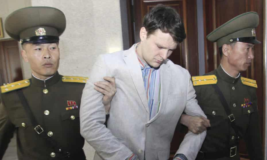 Otto Warmbier escorted by guards at the supreme court in Pyongyang in March 2016.