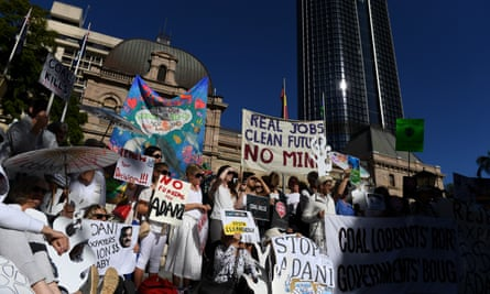 Environmental activists gather outside Parliament House in Brisbane to voice their opposition to Adani's proposed Carmichael coalmine.