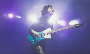 Annie Clark, AKA St Vincent, playing guitar